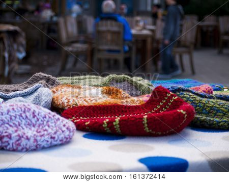 warm wooly beanies being sold at a market