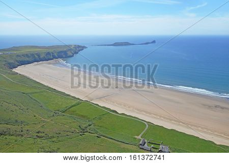Worms head and Rhossili beach in Wales