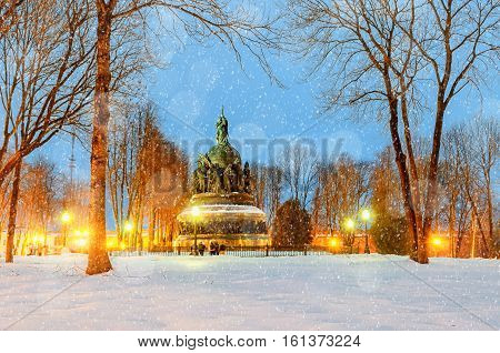 Winter landscape - night park of Veliky Novgorod Kremlin and monument Millennium of Russia in Veliky Novgorod Russia. Winter colorful night scene with Christmas and New Year mood