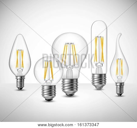 Realistic set of filament led lightbulbs on grey surface vector illustration