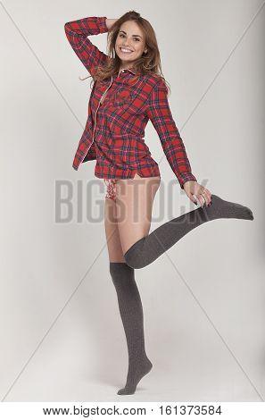Happy teenage girl in funny pajamas on grey background studio. Funky teenager wearing Pajamas cartoon style