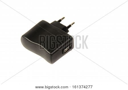 Black USB charger isolated on a white background