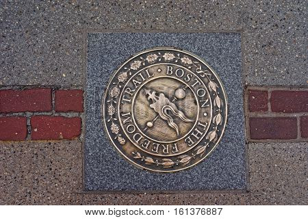Boston, USA - April 27, 2015: Freedom Trail symbol on the road in downtown Boston Massachusetts the United States