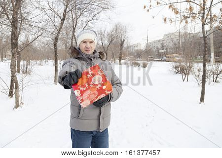 The Man Keeps A Gift In Winter Clothes