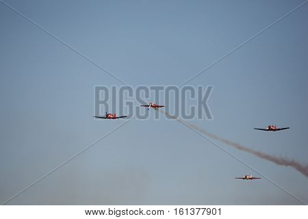 group small sports aircraft in the sky
