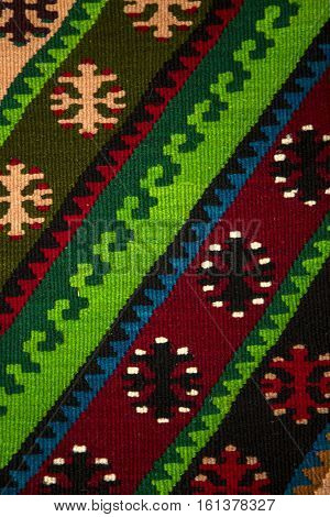 Colorful Serbian style rug surface and handmade carpet