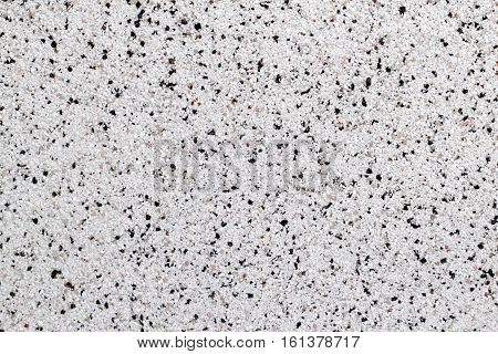 Closeup view of white natural marble chip plaster surface