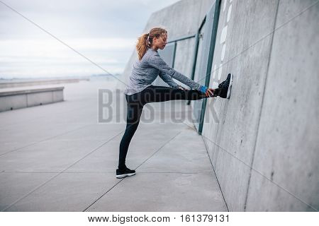 Young Fitness Woman Stretching Outdoors