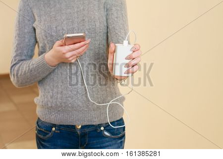 The Girl Shows Charging And Phone Use. Power Bank In Girl's Hands.