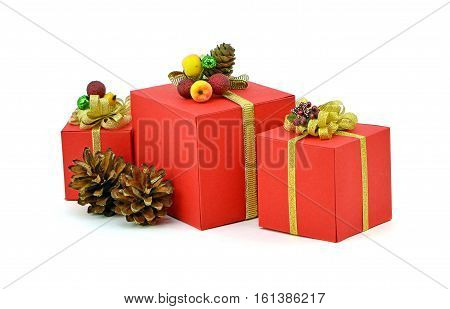 Red gifts boxes pine cones. Isolation on a white background. Christmas gifts decoration frozen berries ribbons and pine cones.