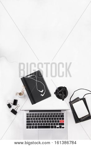 Flat lay of a laptop on a white table surrounded by stationeries. Copy space. Highlighted red APPLY REGISTER NOW button.