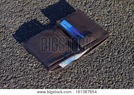 The lost wallet with cash and credit cards on the street