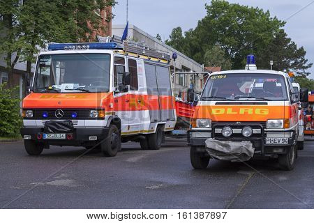 LAUENAU / GERMANY - JULY 13 2013: german DLRG ( German Lifeguard Association ) trucks stands in waiting position for the flood