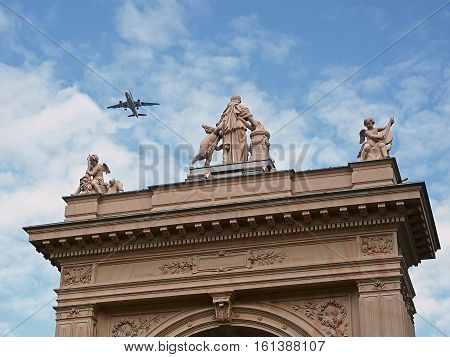 Attica of the portal of municipal park in Pankow with an aircraft