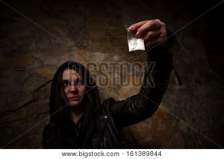 Drug addict holding narcotics or drugs and showing it to camera. Drug addict do not know how to get rid of drug addiction. Drugs concept.