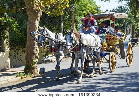 Istanbul Turkey - September 29 2013: Phaeton Horse Car. Coachman Horse Carriage Ride. Buyukada Princes Islands also known as Istanbul is the largest of the islands off the coast. Buyukada motor vehicle is not being used such as Phaeton carriage taxi servi