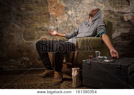 Drug addict Asian man in butt - caught buzz. Man sitting on chair and sleeping. Drug concept. Narcotics concept.