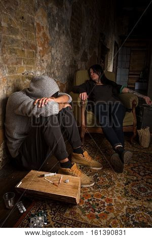 People resting after using heavy drugs. Drugs concept. Drug addict man and woman sleeping after using different types of drugs.