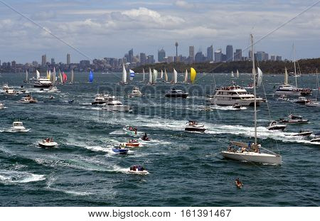 Sydney Australia - December 26 2012. Participants yachts in Sydney Harbour after the start. Sydney to Hobart Yacht Race is an annual event starting in Sydney on Boxing Day and finishing in Hobart.