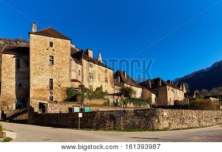 View o the Baume Abbey in Baume-les-Messieurs village. Jura department of Franche-Comte. Baume-les-Messieurs is classified as one of the most beautiful villages of France