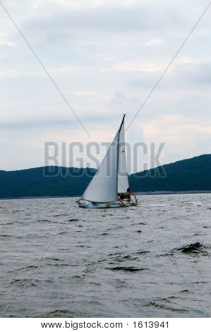 Sailing Under Cloudy Sky