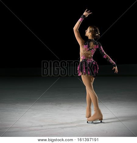 Young girl figure skater (on ice arena ver)