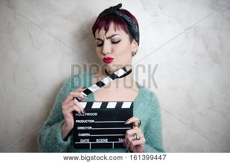 Young Alternative Girl Face With Movie Clapper