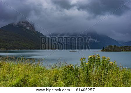 Upper Kananaskis Lake on a stormy day in the Rocky Mountanis near Canmore Alberta Canada
