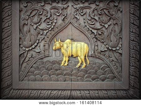 wood carving on the wall of Temple in Thailand