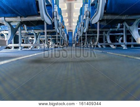 Airplane interior passenger seat and aisle. stock photo