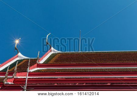 Temple Roof Vintage Thai Style With Against Blue Sky Background