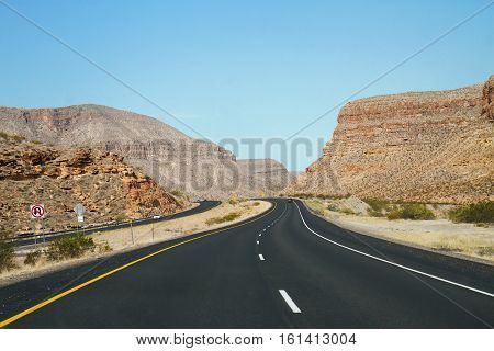 Highway going through the American Southwest desert