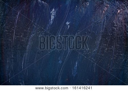 Abstract acrylic painting background in blue color palette.