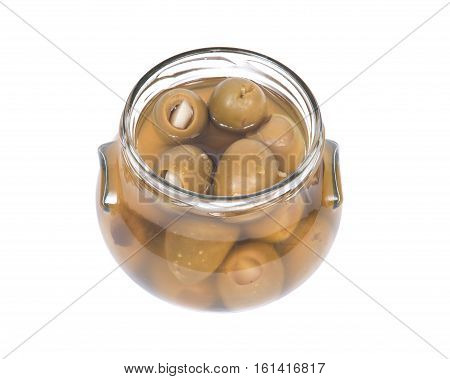 Green colossal olives hand stuffed with garlic gloves in jar isolated on white background