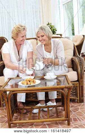 Two senior women meeting and drinking tea