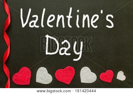 Valentine's day Hand writes on the chalk board. celebration concept