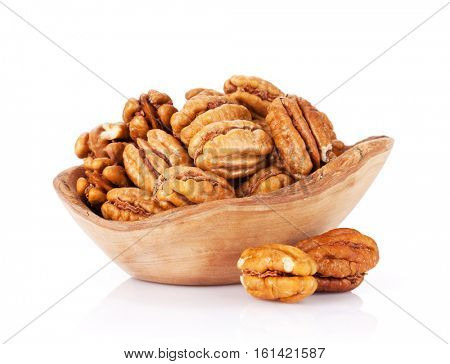 Pecan nuts in bowl. Isolated on white background