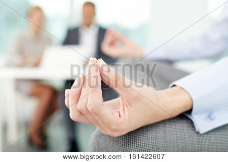 Close-up of a zen-like female hand in office