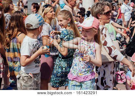 NOVOKUZNETSK KEMEROVO REGION RUSSIA - JUNE 01 2012 :: Children's protection day. Soup bubbles day selebration. Children are blowing soap bubbles