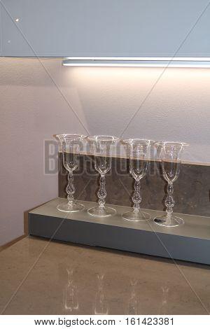 Glass wine glasses on the kitchen shelf