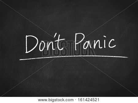 don't panic concept text on blackboard background