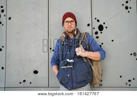 Backpacker standing on concrete wall