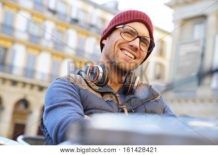 Portrait of hipster guy relaxing in town