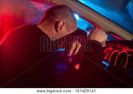 Drunk Man Covering His Face From Police Car Light