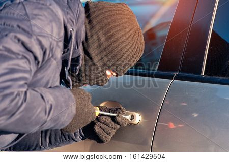 Car Thief Breaking Into Auto Using Screwdriver