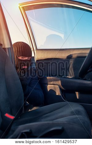 Male Thief In Robbery Mask Unlocking Car Door