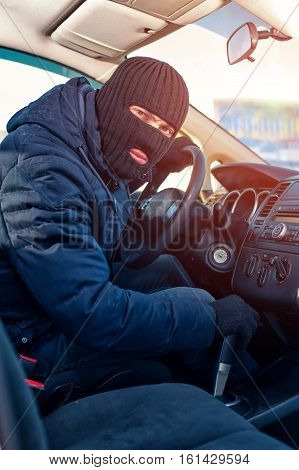 Male Thief In Black Robbery Mask Trying To Run Car
