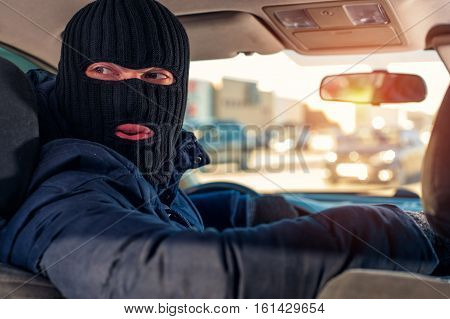 Car Thief In Black Robbery Mask Driving Auto