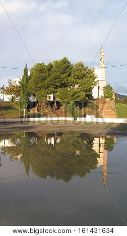 Convent Reflected In Rain Water