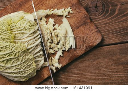 savoy cabbage chopped on a wooden background
